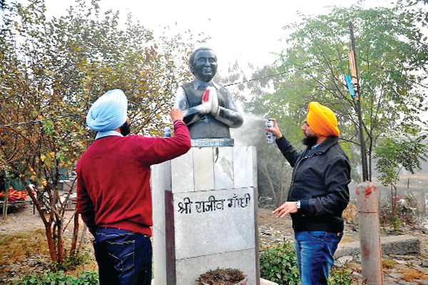 The Youth Akali Dal's Kalikh Mali on the statue of Rajiv Gandhi