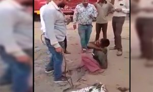 Video, Man, Beaten,Straps, Truck, Market
